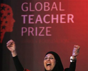 Palestinian primary school teacher Hanan al-Hroub reacts after she won the second annual Global Teacher Prize, in Dubai, United Arab Emirates, Sunday, March 13, 2016. Al-Hroub who encourages students to renounce violence won a $1 million prize for teaching excellence. Photo: AP